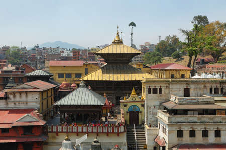 tantra: KATHMANDU, NEPAL - APRIL 20, 2016: tourist and devoted people visiting sacred Hindu temple dedicated to Pashupatinath in Kathmandu, Nepal.