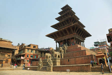 tiers: BHAKTAPUR, NEPAL - APRIL 20, 2016: people around Nyatapola Pagoda in taumadhi Square, Bhaktapur, Nepal. This temple has a pagoda with 5 tiers, it is the tallest temple in the Kathmandu Valley