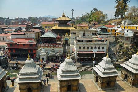 reincarnation: KATHMANDU, NEPAL - APRIL 20, 2016: tourist and devoted people visiting sacred Hindu temple dedicated to Pashupatinath in Kathmandu, Nepal.