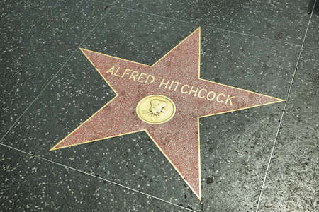 estrellas cinco puntas: LOS ANGELES - JUNE 5, 2016: Alfred Hitchcock star in Hollywood Walk of Fame in Los Angeles, CA. There are more than 2,400 five-pointed stars which attract about 10 million visitors annually