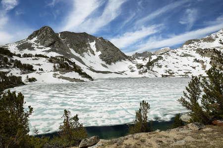 Iced Ruby lake near Mono pass trail, California