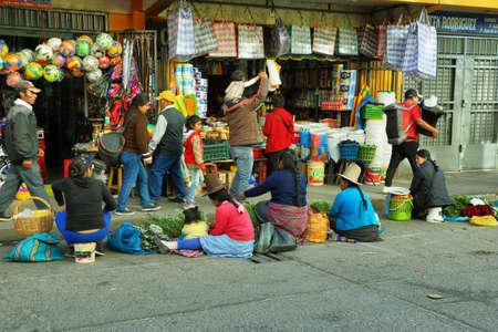 ancash: HUARAZ, PERU - JUNE 5: Women selling herbs in stalls in a commercial street of Huaraz city on June 5, 2017 in Huaraz, Ancash province, Peru