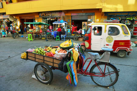ancash: HUARAZ, PERU - JUNE 5: Cart with fresh fruits for sale in a commercial street of Huaraz city on June 5, 2017 in Huaraz, Ancash province, Peru