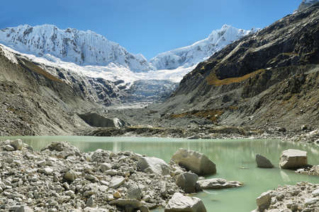 Llaca lagoon (4474 m) in the peruvian Andes and Ocshapalpa peak (5888 m) and Ranrapalca peak (6162 m), Peru