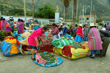 ancash: CARAZ, PERU - JUNE 7: women selling flowers in small stall in a morning flower market on June 7, 2017 in Caraz, Ancash province, Peru