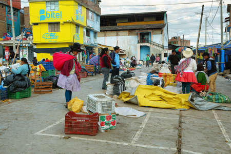 ancash: YUNGAY, PERU - JUNE 7: women selling fruits and vegetables in small stall of Yungay market on June 7, 2017 in Yungay, Ancash province, Peru