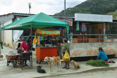 ancash: Chacas, Peru - June 9, 2017: indigenous people in a food stall in village of Chavin de Huantar, Ancash province, Peru.