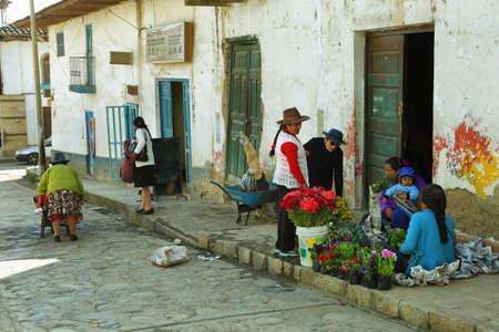 ancash: Chacas, Peru - June 9, 2017: indigenous people selling flowers in village of Chacas, Ancash province, Peru. Editorial