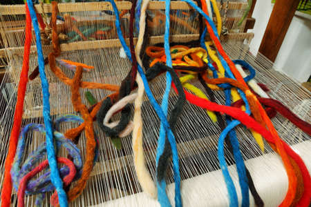 Detail of colorful pure sheep wool in a loom Stock Photo