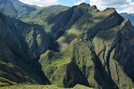 unexplored: Sheer mountains nad Carhua semicircular inca platforms from Huamanmarca in Nor Yauyos Cochas, Peru