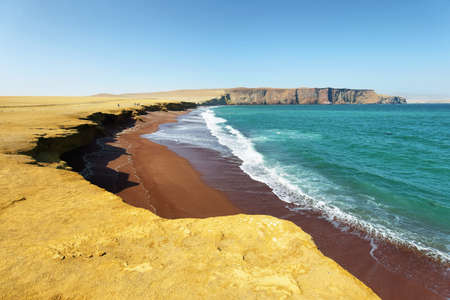 The coast and red sand beach of Paracas National Reserve in Peru Stock Photo