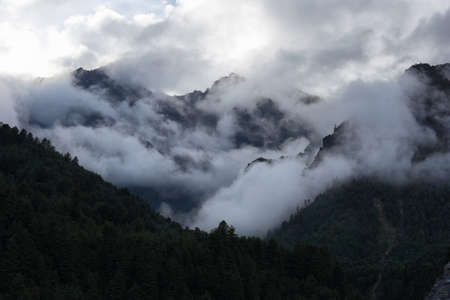 Cloudy mountain views on the way to Phakding in EBC trekking in Nepal