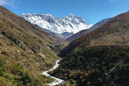 Nuptse and Lhotse peaks views with winding river foreground in EBC trekking in Nepal