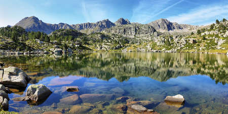 Lake in Collada de Pessons, Pyrenees. Andorra. Foto de archivo - 104240527