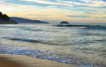 Sunset in Laga beach, Basque country, spain. Beautiful beach for surfing and bathing.