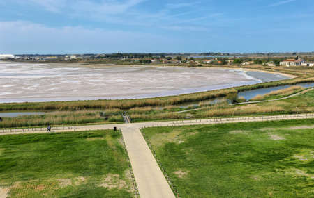 Salt flats and salins in front of medieval village of Aigues Mortes, France