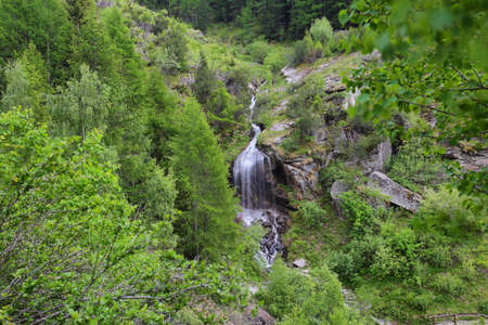 Lillaz waterfall among rocks, Aosta Valley, Alps of Italy