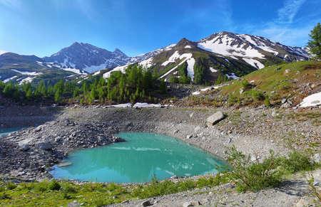 Alps of Italy, Veny Valley, Miage Lake in Aosta Valley, Italy Stock Photo - 128724770