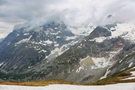 View of mountain peaks with glaciers in Val Ferret, Aosta valley, Italian alps