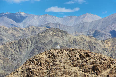 Views of a buddhist stupa and desert mountains from Hemis monastery in Ladakh, north of India