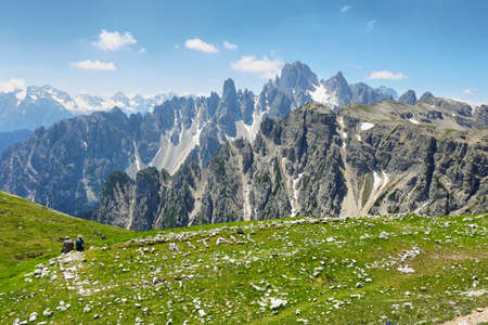 couple looking at great view of the top Cadini di Misurina range in National Park Tre Cime di Lavaredo. Dolomites, South Tyrol, Italy Imagens