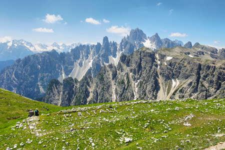 couple looking at great view of the top Cadini di Misurina range in National Park Tre Cime di Lavaredo. Dolomites, South Tyrol, Italy Banco de Imagens