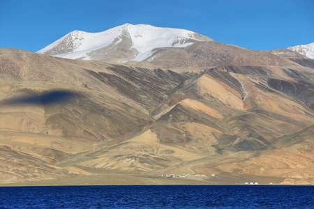 Tso Moriri lake in Rupshu valley with Chamser Kangri peaks at background in Ladakh, India