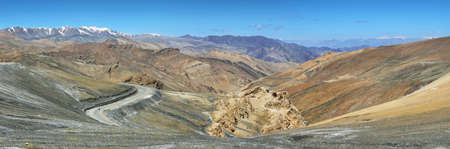 View of hairpin turns and mountains in Taglang La pass, the second highest motorable road in the word, Ladakh, India Stock Photo