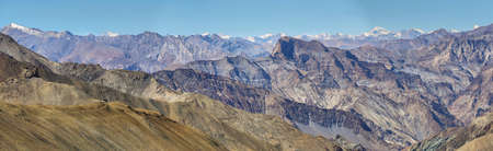 Panoramic view of mountains and snow capped peaks of himalaya's from Ganda La Pass in Markha Valley Trek - Ladakh, India Stock Photo