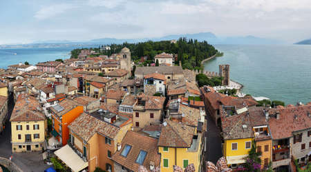 Landscape of Sirmione Village with Lake Garda and Alps. It is a famous vacation place in the northern Italy.