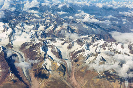Aerial view of glaciers and himalayas in Ladakh region from the airplane window, India. 写真素材 - 143416204