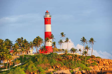 Lighthouse on the rocks near the ocean in Kovalam, Kerala, South India