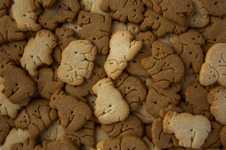 A pile of animal crackers that look good enough to eat. Imagens