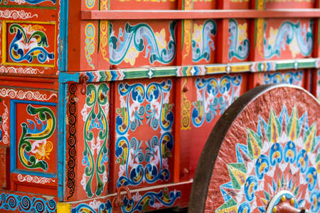 This is a beautiful blue and red wagon used to transport coffee beans on a historic plantation. Imagens