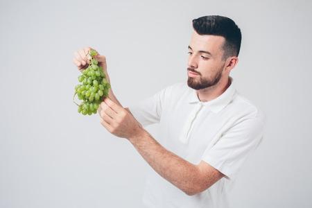 man grapeholding close up