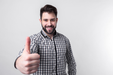 man with thumbs up - isolated over light background