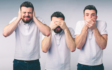 Isolated studio shot of a Caucasian woman in the See No Evil, Hear No Evil, Speak No Evil poses