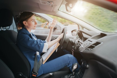 A woman feels stress on the road. Big Traffic jams. Business woman is late for work