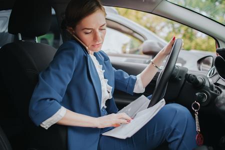Businesswoman doing multiple tasks. Multitasking business person.