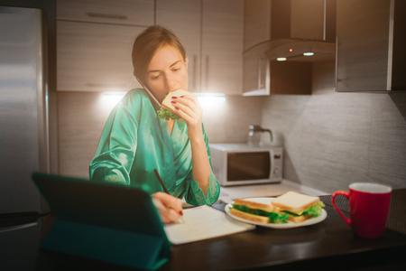 Businesswoman doing multiple tasks. Multitasking business person. Freelancer works at night.