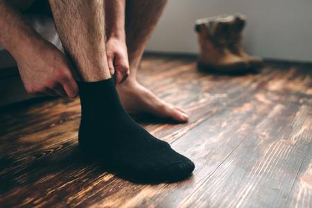 The man wears black socks. Mens style.