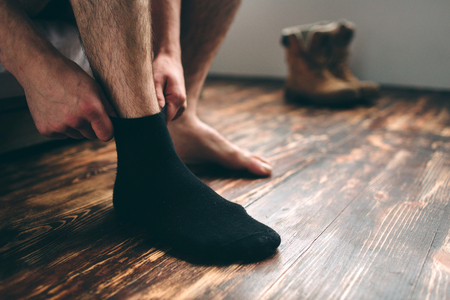 The man wears black socks. Mens style.