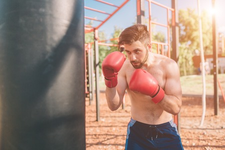 Young man boxing workout. Boxer Exercise Athletic Boxing Concept. boxer punch hand by punching bag.
