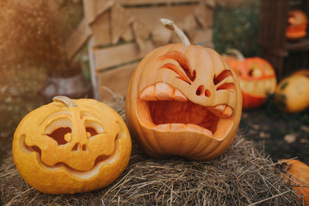 Ghost pumpkins on Halloween. ead Jack on an autumn background. Holiday outdoor decorations. Stock Photo