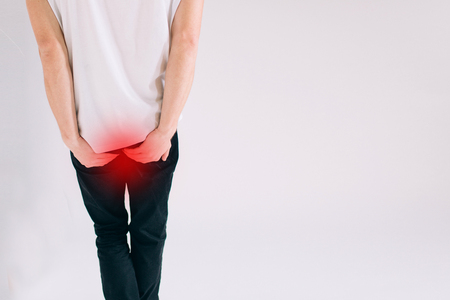 man has Diarrhea Holding her Butt amd isolated on White Background Stock Photo