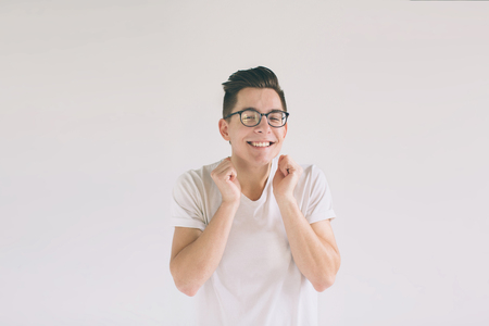 Man in white t-shirt and glasses with big smile isolated on white background. A very kind student has a good mood Stok Fotoğraf - 93635142
