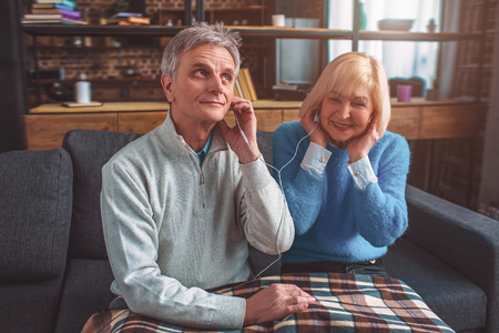 Old but beautiful people are listening to music through the head Stock Photo