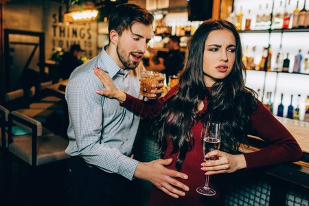 Very drunk man want to meet with beautiful girl. She refuses to meet with a guy who drank too much alcohol. She doesn;t like him at all.