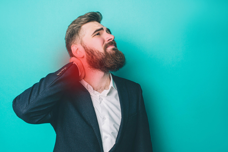 A picture of man that has a pain in the neck. The pain point is marked by red light. Guy is suffering from it. Isolated on blue background