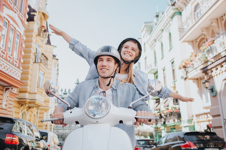 Happy couple are riding on motorcycle Stock Photo